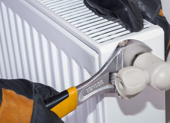 How to Remove a Radiator to Paint or Paper Behind it